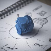 Drawing of a lightbulb with a piece of blue tac at the centre